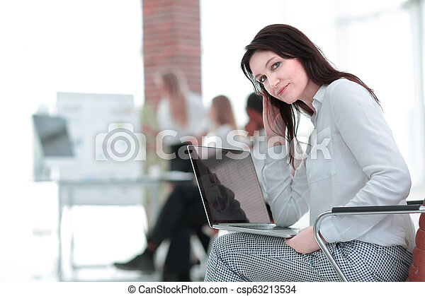 smiling business woman with laptop on blurred background - csp63213534