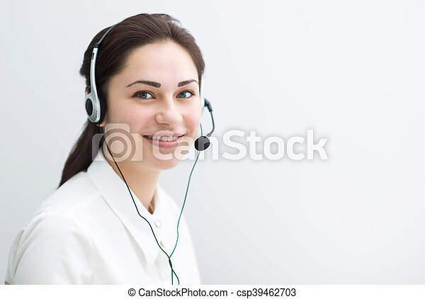 smiling business woman working in a call center - csp39462703