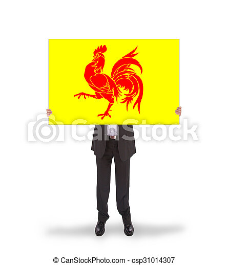 Smiling businessman holding a big card, flag of Wallonia - csp31014307