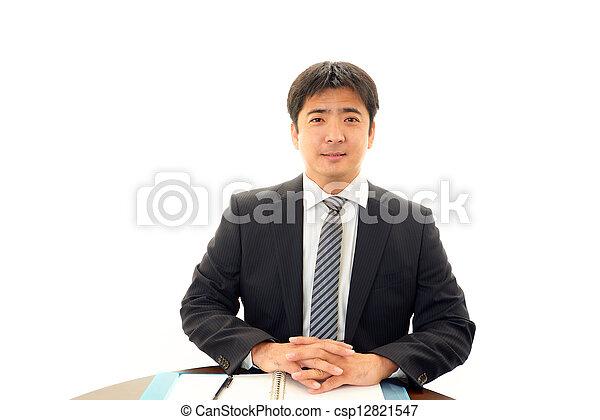 Smiling businessman - csp12821547