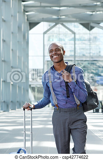 smiling businessman traveling with bags - csp42774622