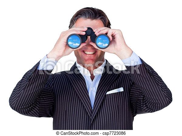 Smiling businessman using binoculars - csp7723086