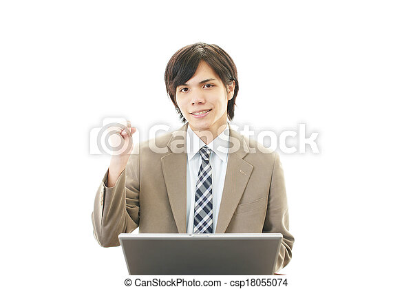 Smiling businessman using laptop - csp18055074