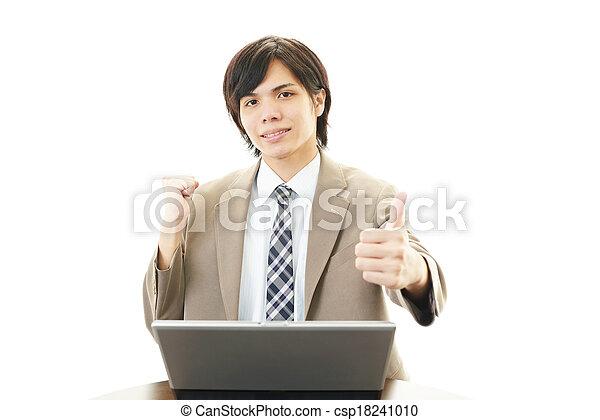 Smiling businessman using laptop - csp18241010