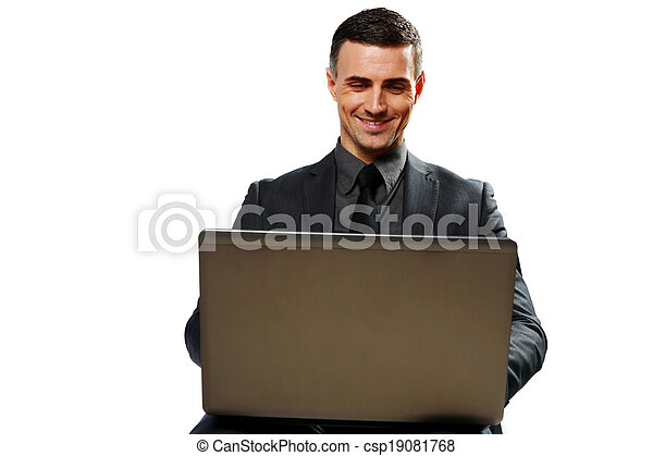 Smiling businessman using laptop isolated on a white background - csp19081768