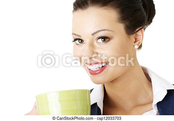 Smiling businesswoman having coffee break - csp12033703