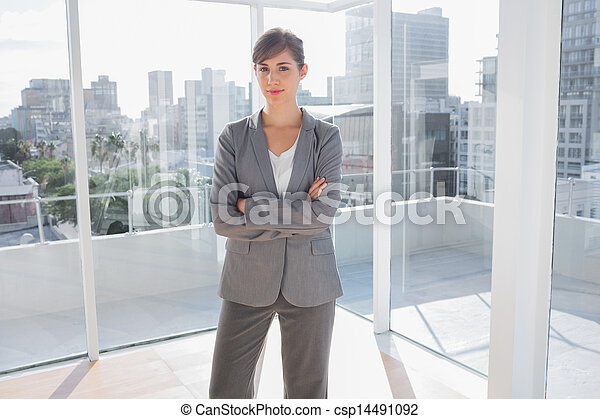 Smiling businesswoman in office - csp14491092