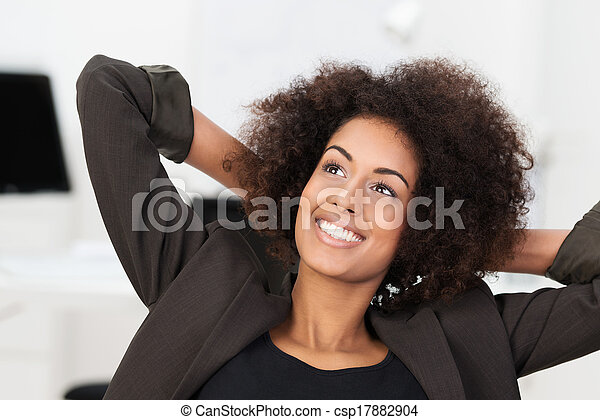 Smiling businesswoman smiling as she relaxes - csp17882904