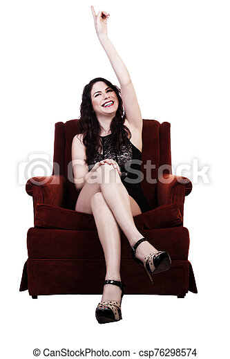 Smiling Caucasian Brunette Woman Sitting In Chair Pointing Up - csp76298574