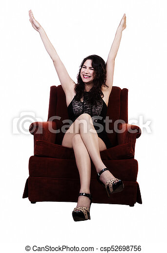 Smiling Caucasian Woman Sitting In Chairs With Arms Up - csp52698756