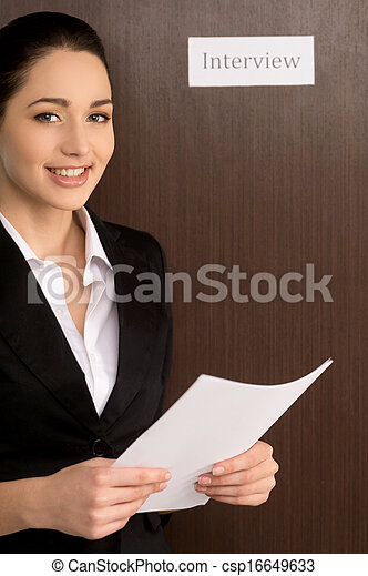 Smiling confident woman standing with CV. Getting ready for interview  - csp16649633