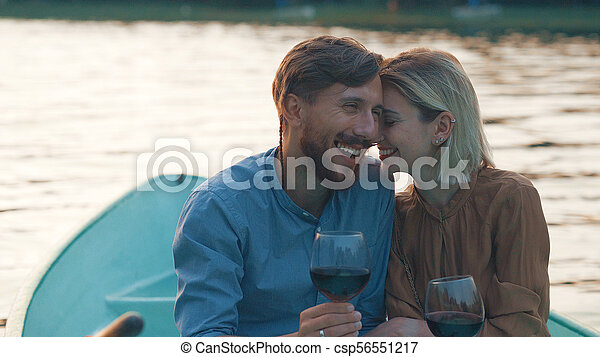 Smiling couple in a boat - csp56551217