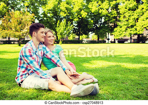 smiling couple in park - csp27048913