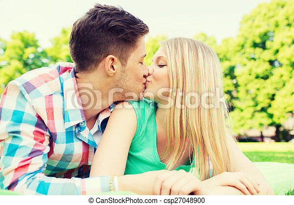 smiling couple in park - csp27048900