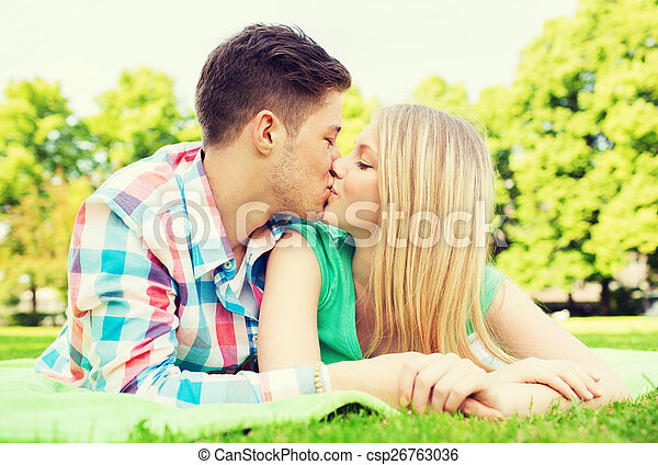 smiling couple in park - csp26763036