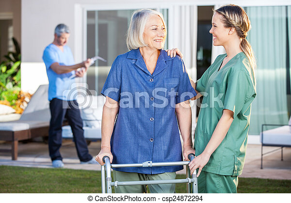 Smiling Disabled Woman And Nurse Looking At Each Other - csp24872294