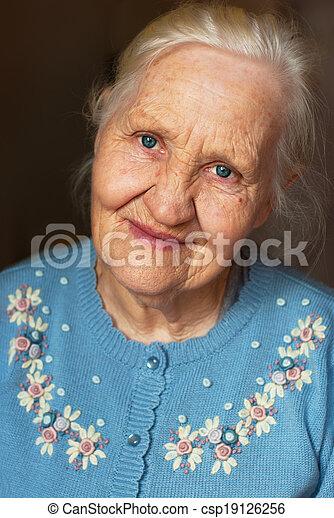 Smiling elderly woman - csp19126256