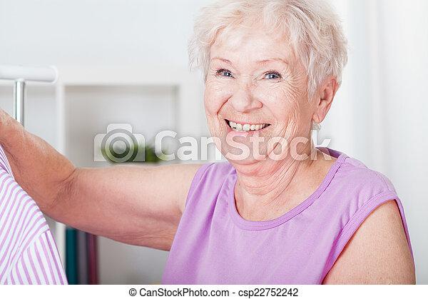 Smiling elderly woman - csp22752242
