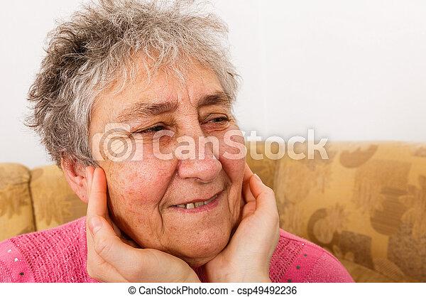Smiling elderly woman - csp49492236