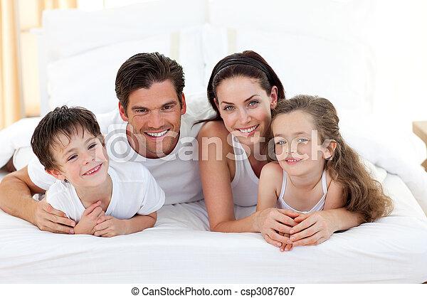 Smiling family having fun - csp3087607