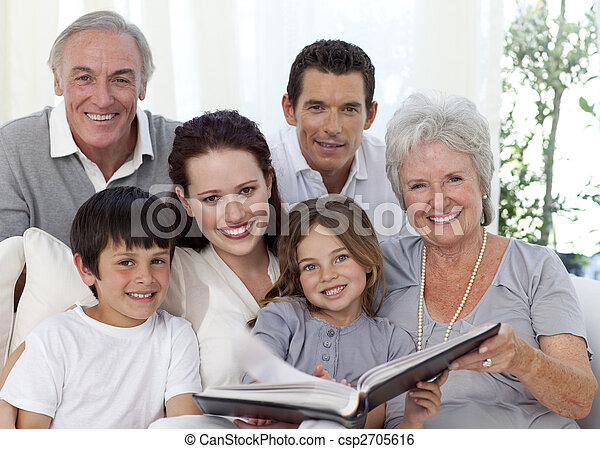 Smiling family looking at a photograph album - csp2705616