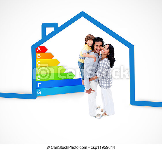 Smiling family standing with a blue house illustration with energy rating on a white background - csp11959844