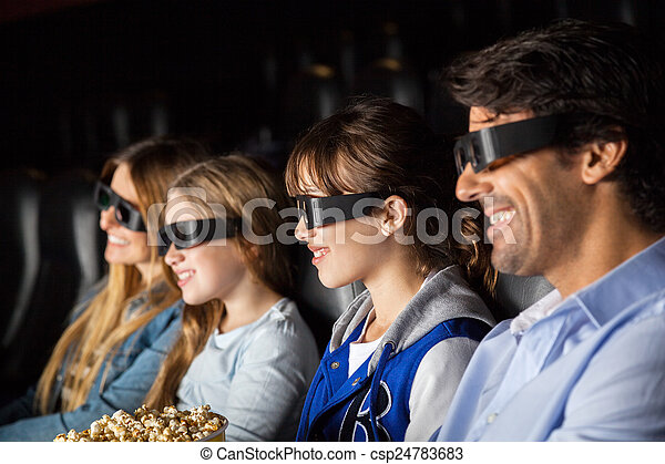 Smiling Family Watching 3D Movie In Theater - csp24783683