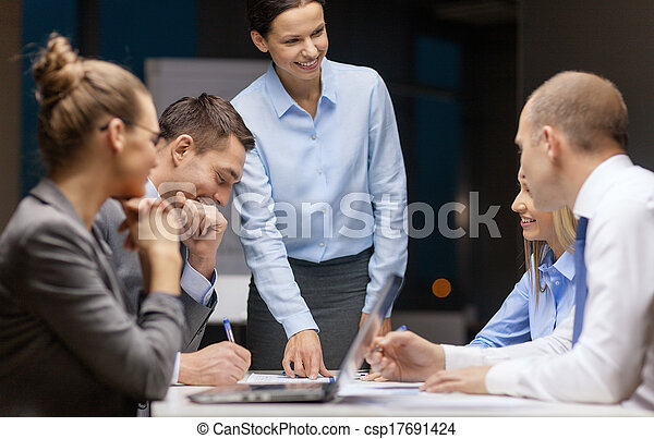 smiling female boss talking to business team - csp17691424