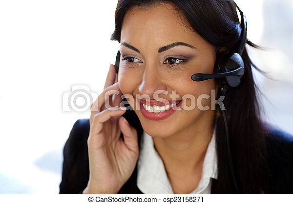 Smiling female customer support operator with headset - csp23158271