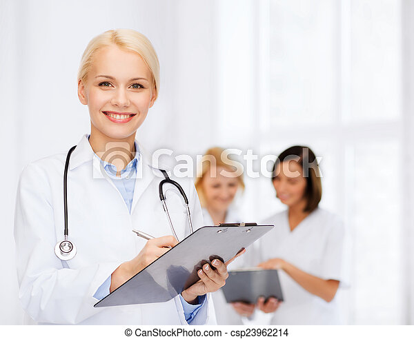 smiling female doctor with clipboard - csp23962214