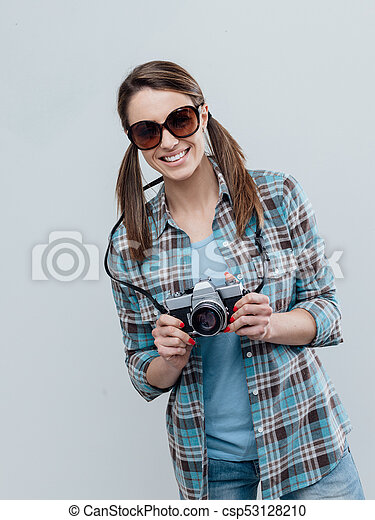 Smiling female photographer - csp53128210