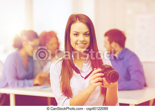 smiling female photographer with photocamera - csp40122089
