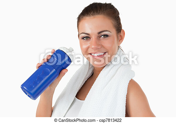 Smiling female with her bottle after workout - csp7813422
