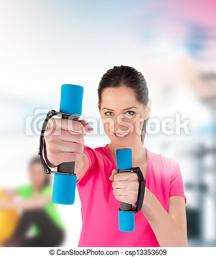 Smiling fitness woman lifting weights  - csp13353609