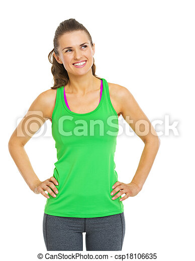 Smiling fitness young woman looking on copy space - csp18106635