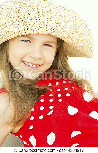 smiling girl in hat on beach - csp14304917