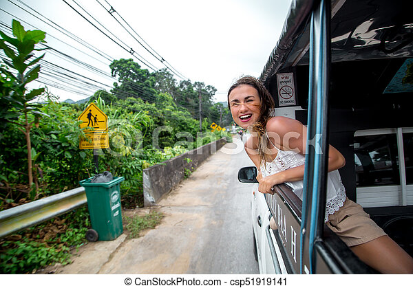 smiling girl looks out of the window of a taxi, tuk-Tuk - csp51919141