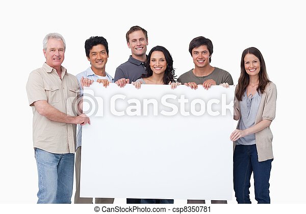 Smiling group holding blank sign together - csp8350781