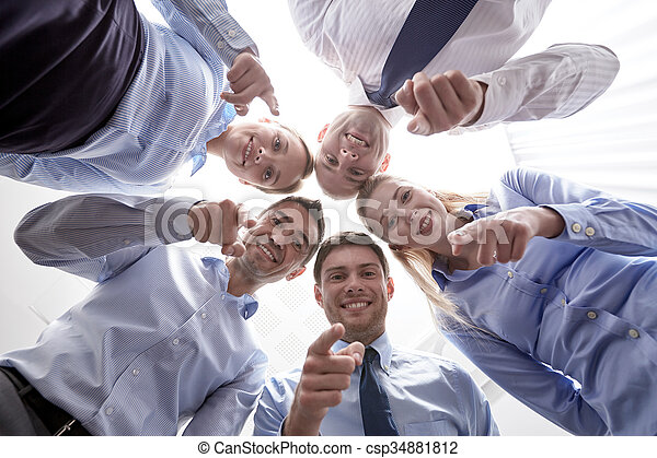 smiling group of businesspeople standing in circle - csp34881812