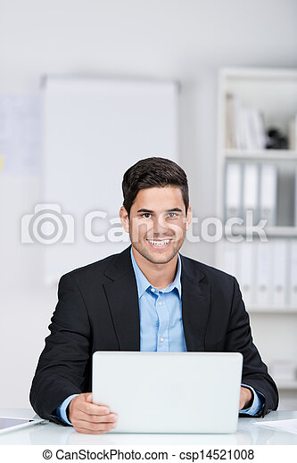 Smiling handsome businessman by the office - csp14521008