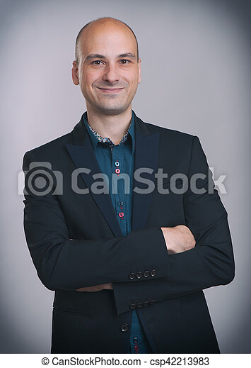 smiling handsome businessman in suit - csp42213983