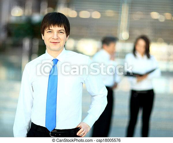 smiling handsome businessman - csp18005576