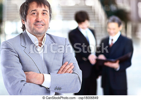 smiling handsome businessman - csp18006849