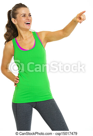 Smiling healthy young woman pointing on copy space - csp15017479
