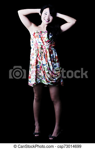 Smiling Japanese American Woman Standing In Floral Dress - csp73014699
