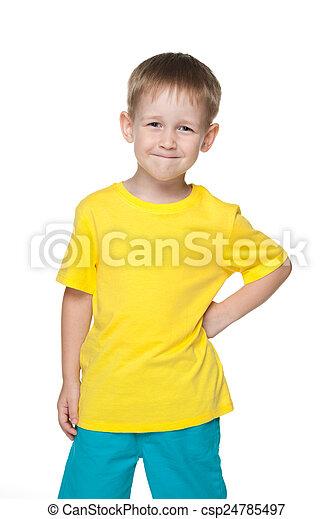 Smiling little boy in a yellow shirt - csp24785497