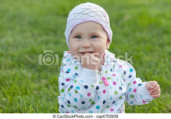 Smiling little girl in the polka dot jacket - csp4753939