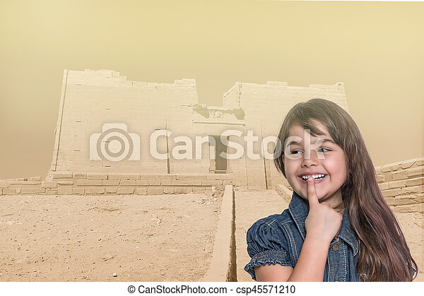 Smiling little girl is standing in front of Temple of Kalabsha - csp45571210