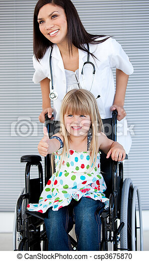 Smiling little girl sitting on the wheelchair - csp3675870