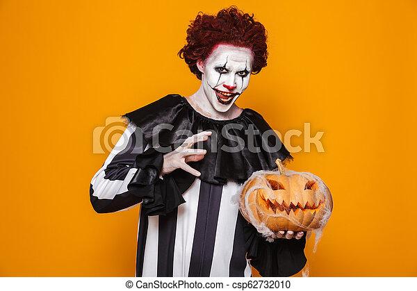 Scary Clown Halloween Costume.Smiling Man Dressed In Scary Clown Halloween Costume